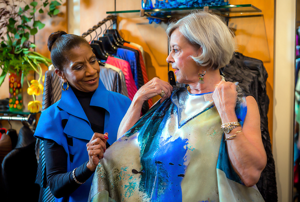 In addition to having a superb knack for finding the right pieces for the right person, Theresa can tell you about the artists who created the clothing we carry.