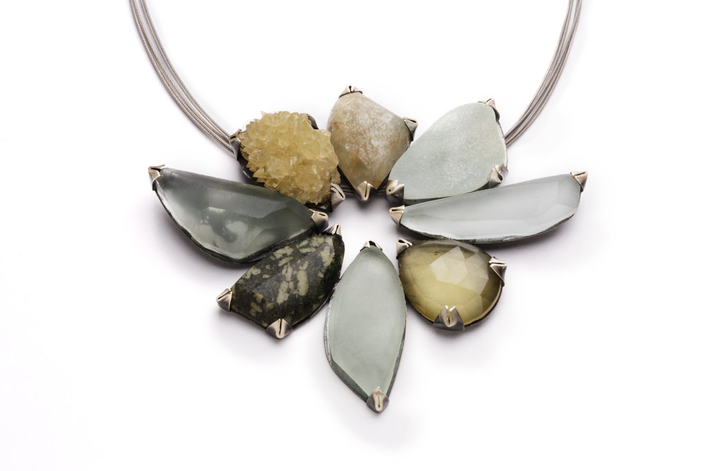 Terri Logan's jewelry features mineral elements: metal, rock, and crystal.
